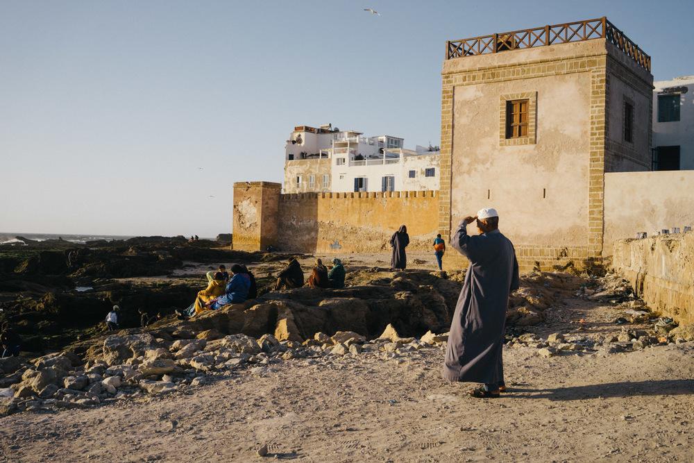 Locals enjoying the sunset in Essaouira.
