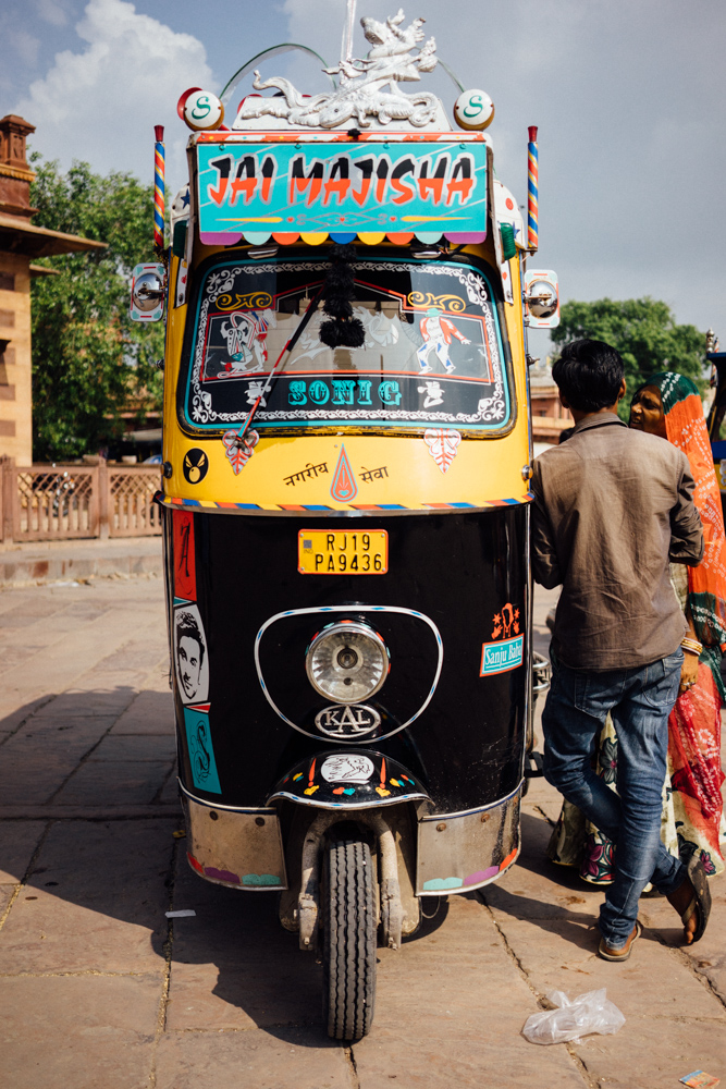 An Indian auto tuk driver waiting for a customer.