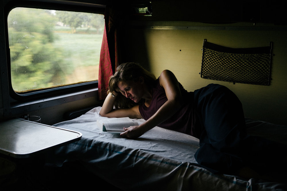 Passing the time aboard our sleeper train.