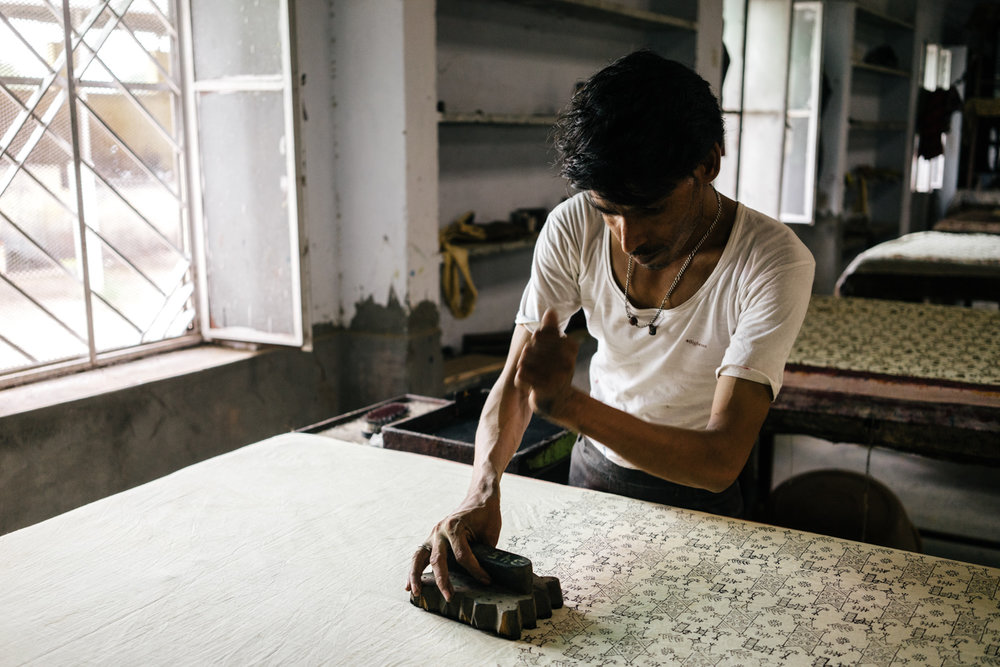 A block printing worker doing his thing. Naturally he was way more efficient than we were.