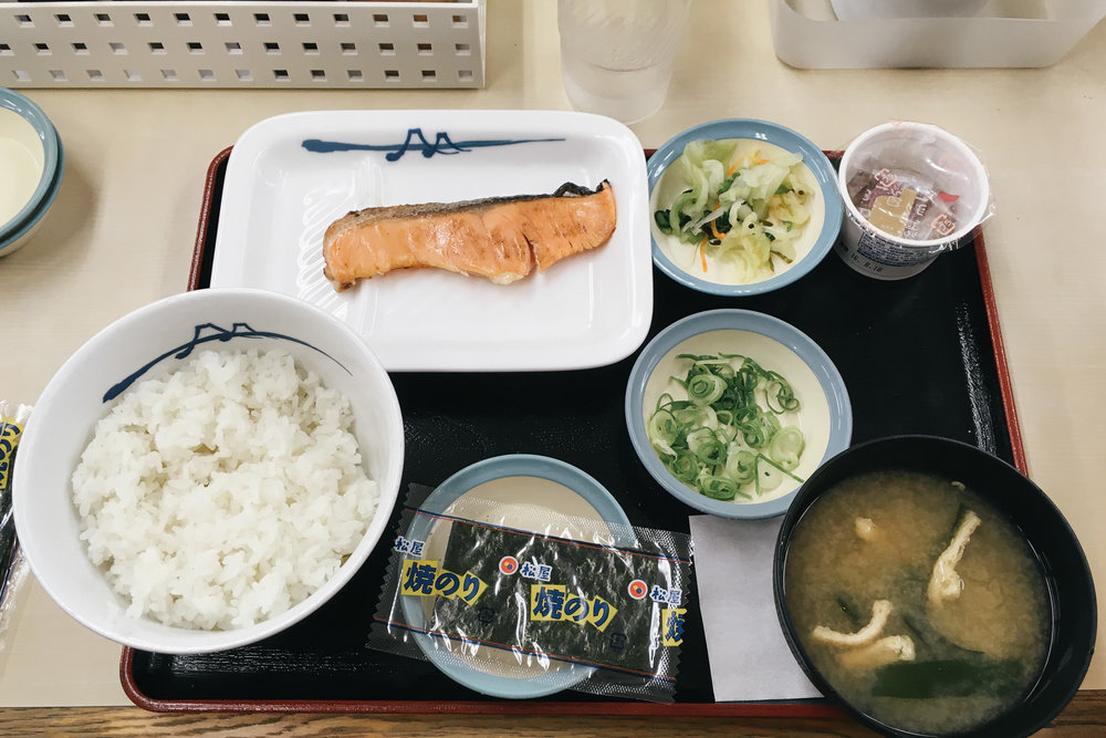 Typical Japanese breakfast with cured fish and fermented soy beans (which have a horrible odor).