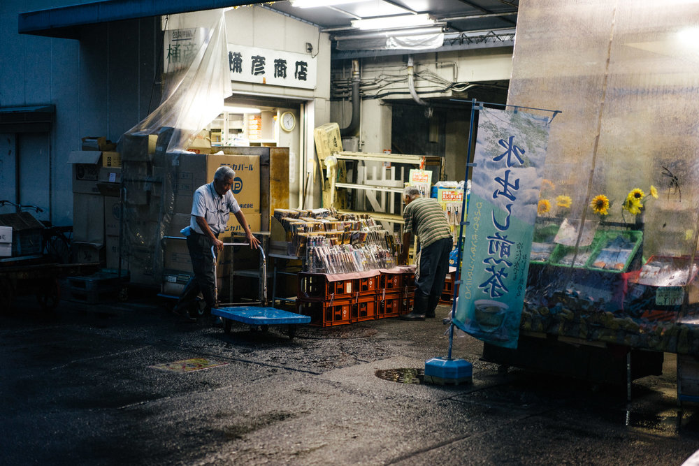 Late night at the Tsjukiji Fish Market (above). Soaking wet after running home from the fish market.