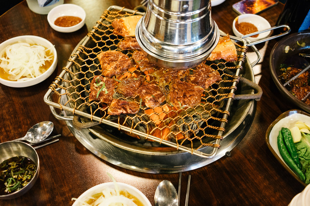 (Above) Mouthwatering Korean BBQ. (Below) Daniel Gray from Delectable Travels showing us how it's done in Seoul.