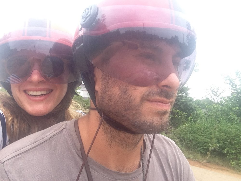 The moment right before we fell over and rolled around in wet Cambodian red mud.