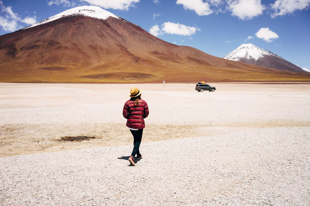 Walking toward our ride for the next three days with a fresh passport stamp from Bolivia.