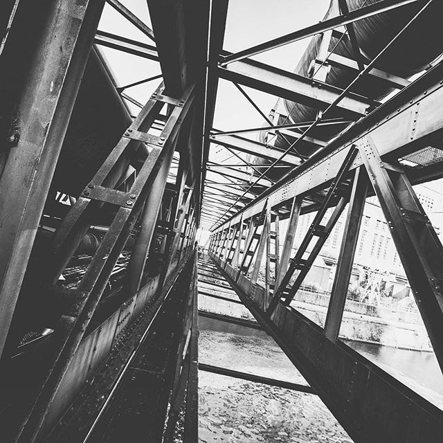📷 Belgium Bridges. 2014.  Quick iPhone shot whilst walking to an abandoned location in Belgium. Loved this bridge.  #bw #blacknwhite_perfection #blackandwhite #monochrome #mono #industrial #instagood #ig_podium #ig_captures #igblacknwhite #explore #exploring_shotz #neverstopexploring #urbex #urbextreme #decay #rsa_outdoors #bridgeporn #bridges #rsa_photo_of_the_day #ig_photooftheday