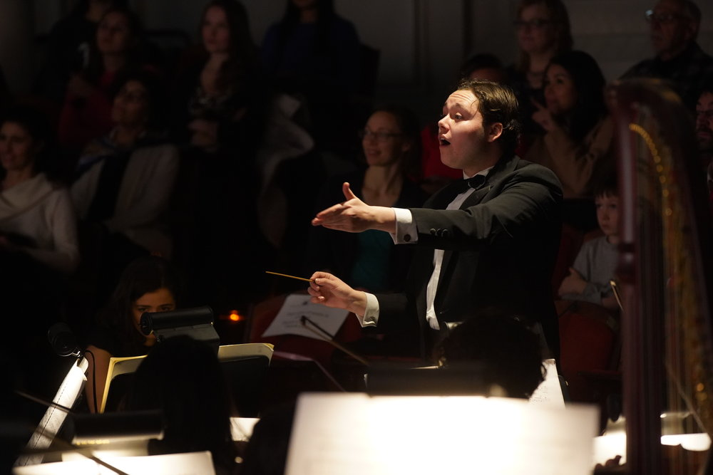 Benjamin P. Wenzelberg conducts the Harvard College Opera orchestra in Massenet's  Cendrillon . Photo: Charles Wenzelberg.