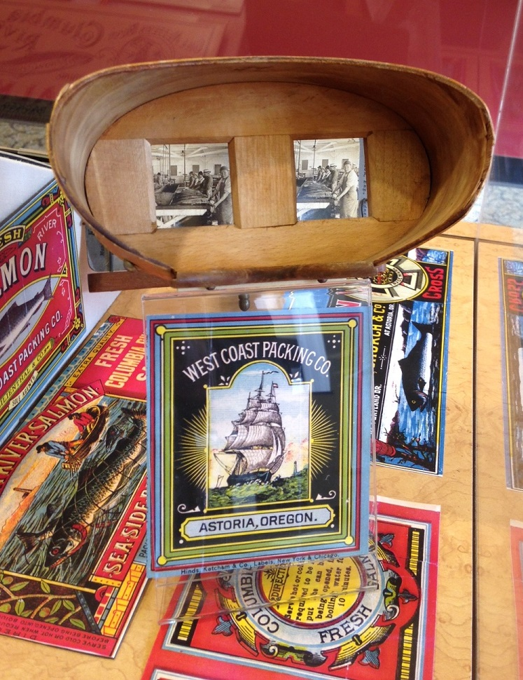 Cannery ephemera and a stereoscopic view of the inside of an Astoria cannery, all on display within a bank in Astoria.