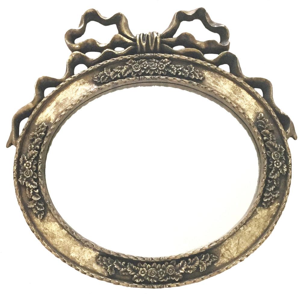 gold bow mirror.jpg