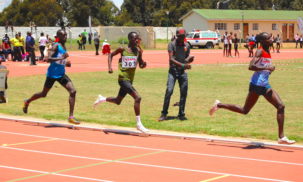 Ezekiel Kemboi waiting to make his move in the men's 1500 meters...