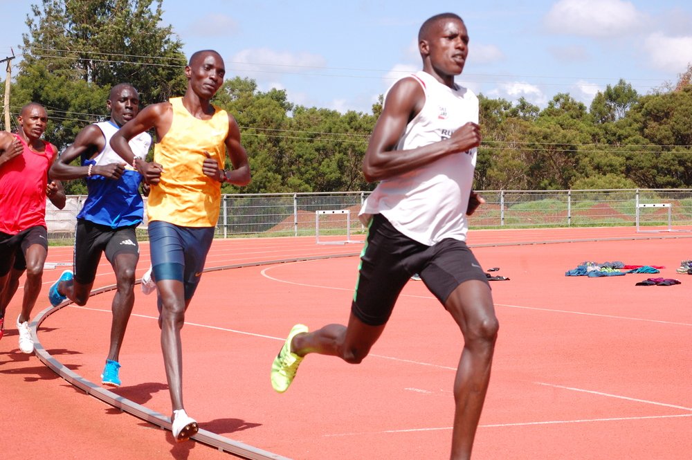 Pace setter Andrew Rotich leading Asbel Kiprop (Gold)