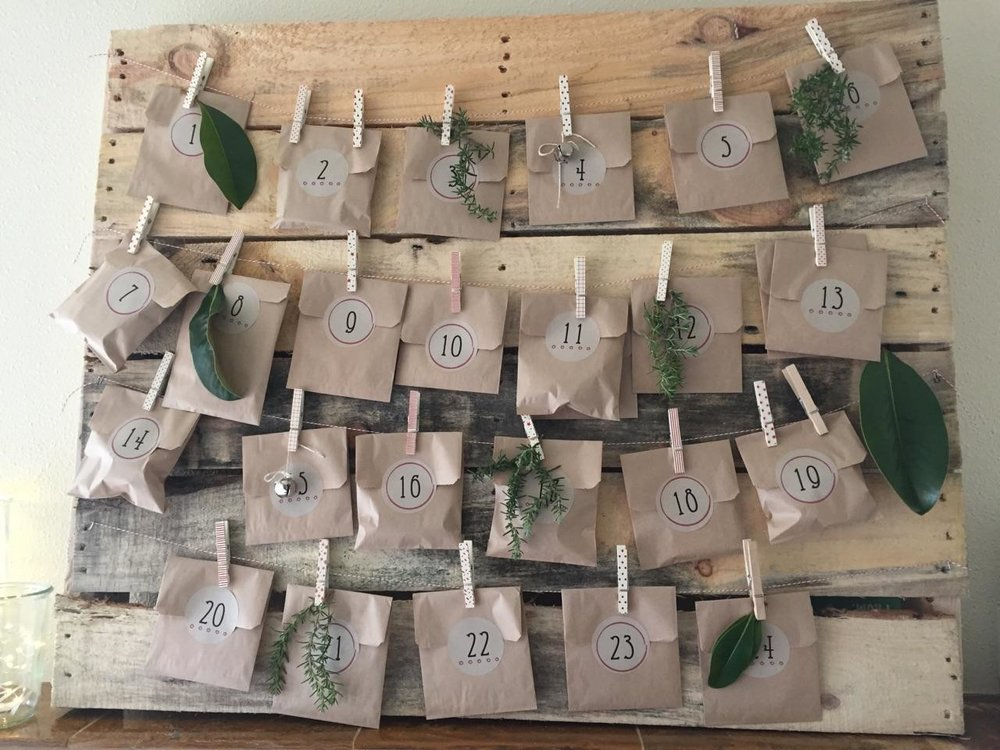 Our friend Jen added    With a Bow's    custom   Advent Calendar Tags to her countdown to Christmas goodie bags, filled with little treats for her girls.She sealed each bag with a custom  With a Bow  numbered sticker and strung them on an old pallet, complete with Christmas clothes pins, rosemary, leaves, and jingle bell accents.It is the perfect mantel decor for the holidays as well as extremely enticing for her little ones.The girls can't wait for the countdown to start tomorrow!