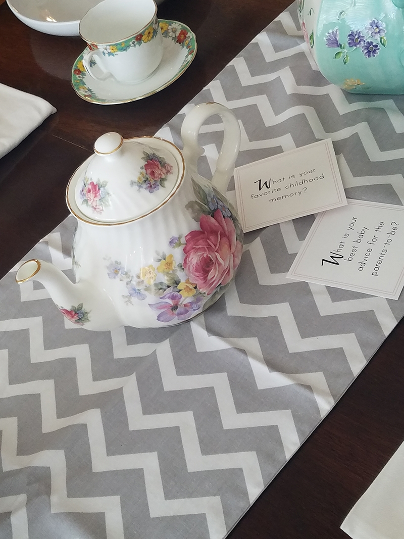 Grey chevron print table runner and themed conversation starters from   B is for Baby box  .