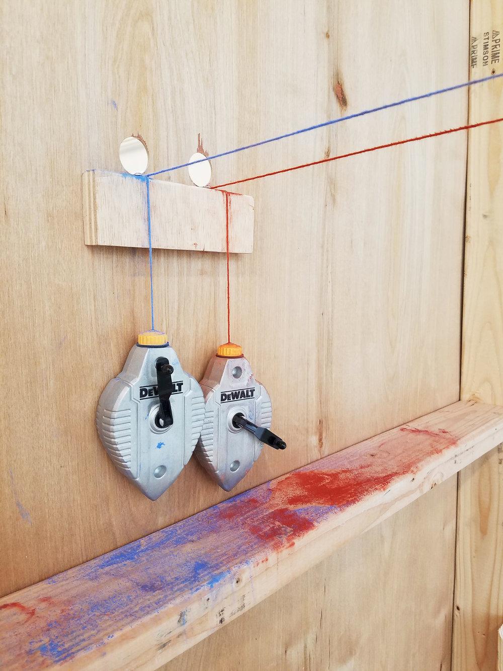 "Parallax 8: After Wells  2×4s, plywood, paint, chalk line 2017 96"" × 48""× 24"" Derek Frankhouser"