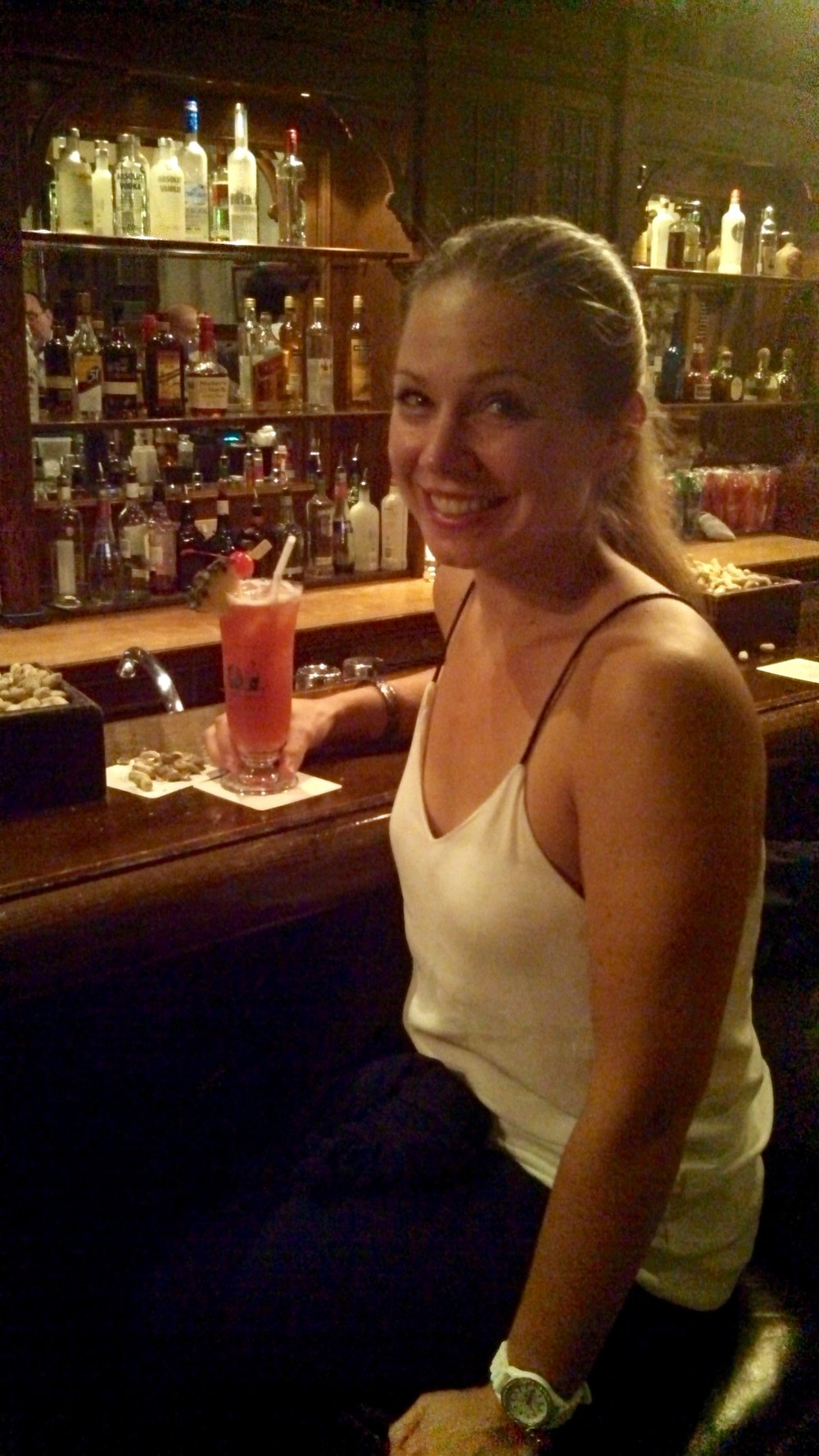 Enjoying an original Singapore Sling cocktail at the Raffles Hotel in Singapore