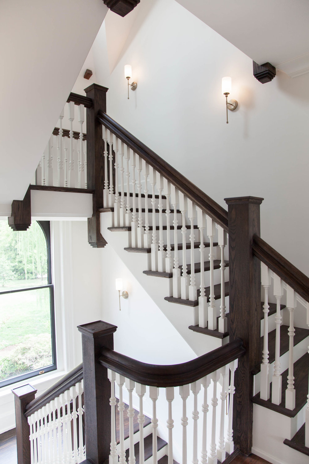 Three-story staircase with perfectly restored bannisters.