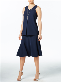 An inverted pleat on the blouse and the flare of the skirt are modern yet forgiving. In Navy (shown), White, Black and Crimson. Blouse, $225; skirt, $250.