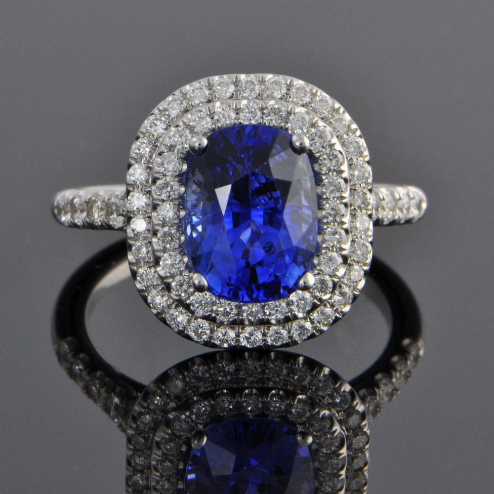 Estate ring in 14k white gold with a 3.05 carat sapphire surrounded by seventy diamonds totaling 0.62 carats. $14,600. Perry's Fine Antique & Estate Jewelry.