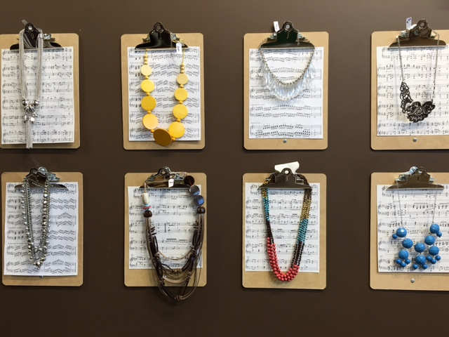 Clipboards with sheet music make a clever display for jewelry at the new GW boutique.
