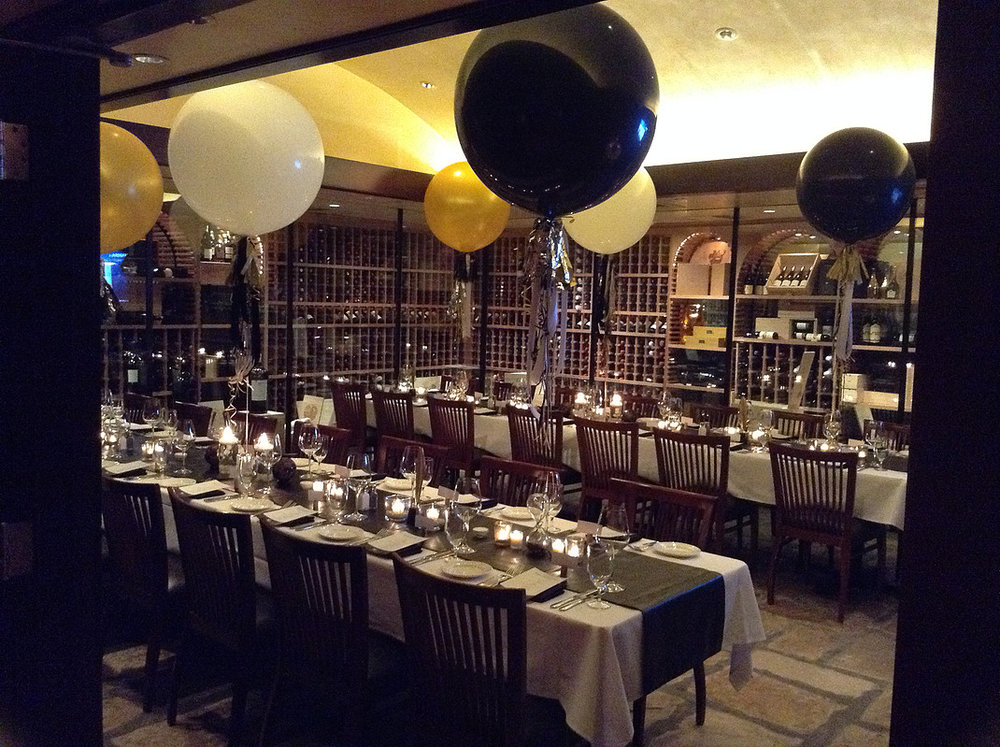 For this male client's 40th birthday party in Del Frisco's wine cellar, Portia put together a festive but masculine table with unique touches including faux leather table runners and sand-filled hour glasses made of Mercury Glass as a nod to the passing of time.