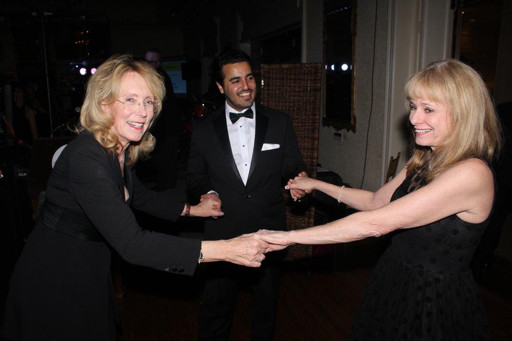 Guest of honor Ali Al-Hajri dances with Suzie Trivisonno, left, and bestselling author Kathy Reichs.