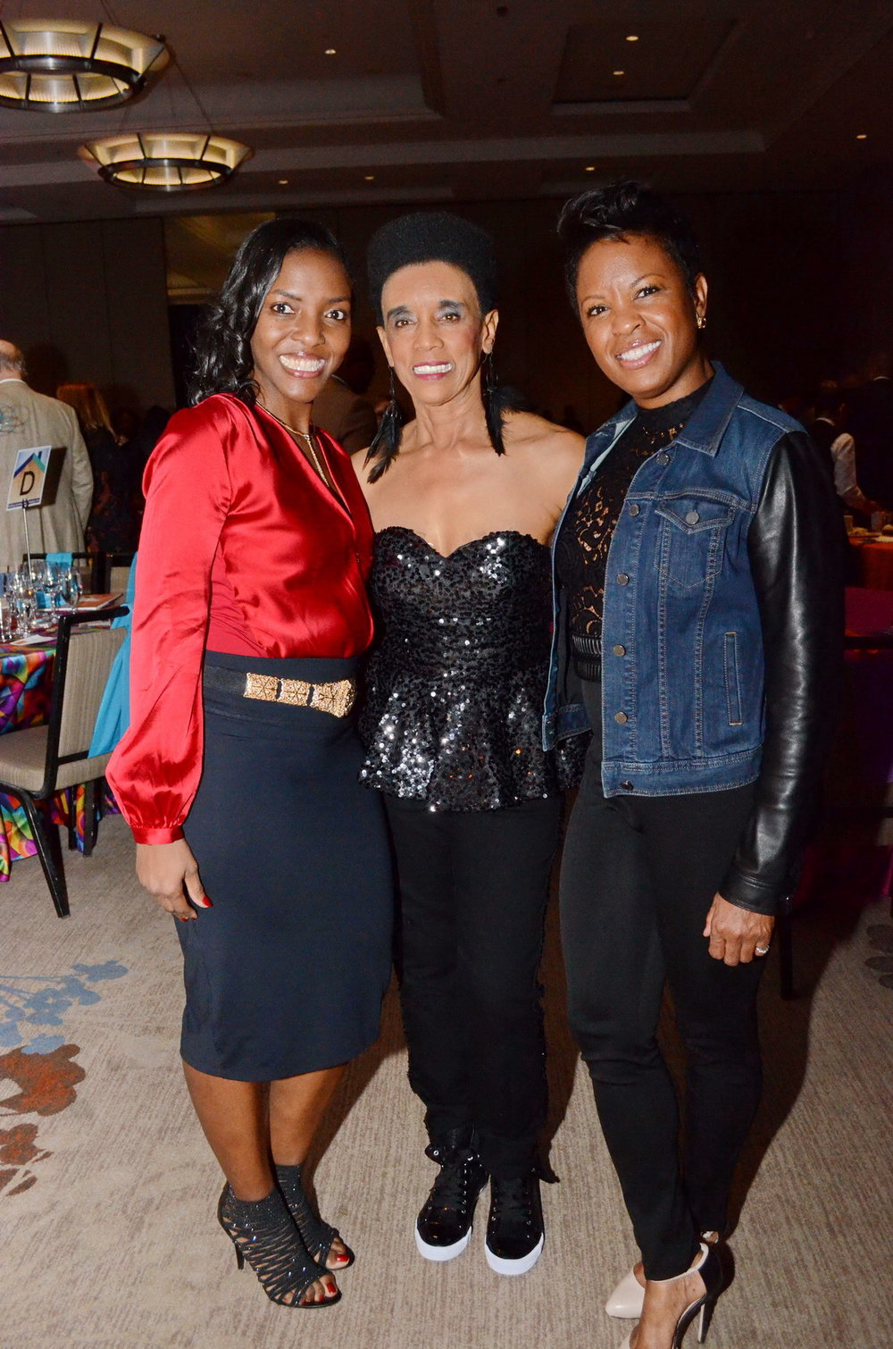 The evening's hostess, Dee Dixon, center, the president and CEO of Pride Communications.