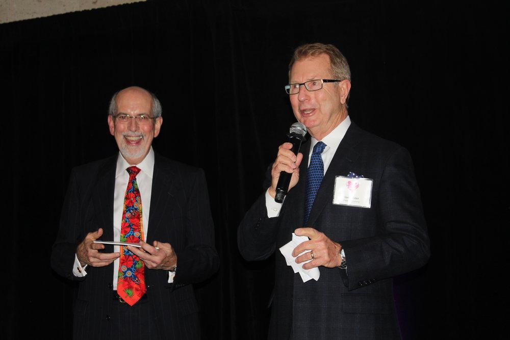 Auctioneer Ernest Perry with Elder Gallery owner Larry Elder.