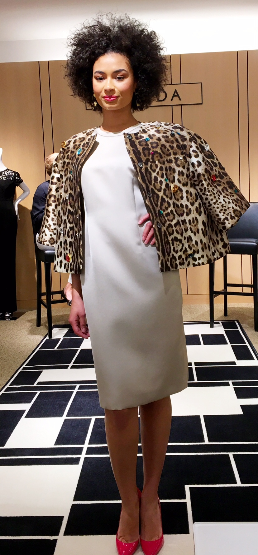 An elegant and exciting spring look from Neiman Marcus at SouthPark mall: An Escada dress, Dolce & Gabbana animal print embellished jacket and pink patent leather shoes.