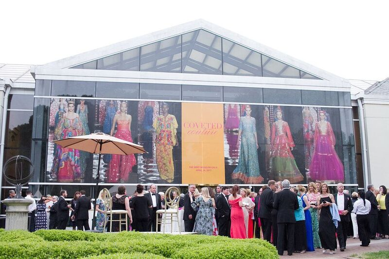 In keeping with the Coveted Couture theme of the Mint Museum's spring gala, images of models walking in New York Fashion Week were projected onto the front of the art museum.   Photos courtesy of Old South Studios.