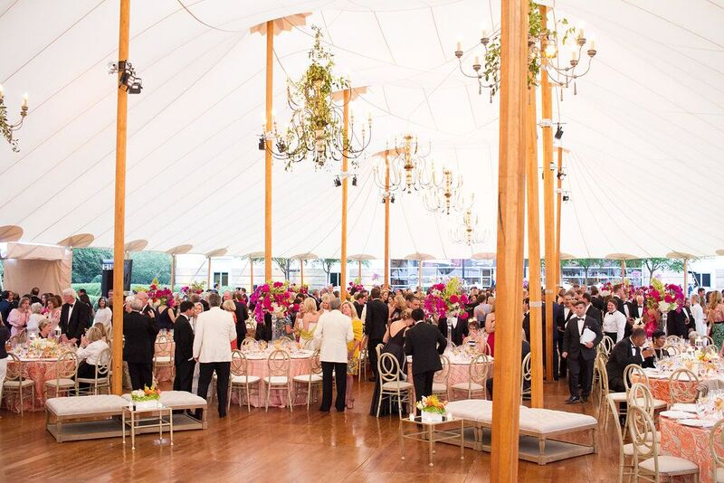 The spectacular sailcloth tent with a wood plank floor, chandeliers and sumptuous decor.