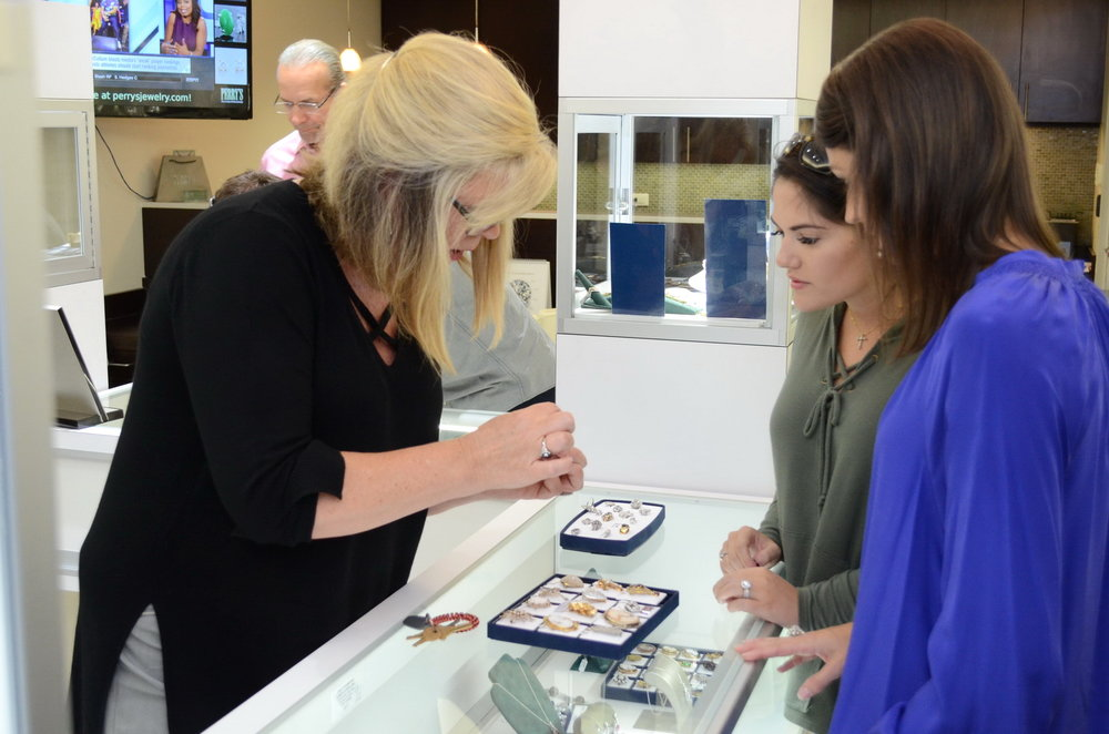 Julie Lopett shows friends Morgan Petty and Brittany Logano vintage jewelry pieces.