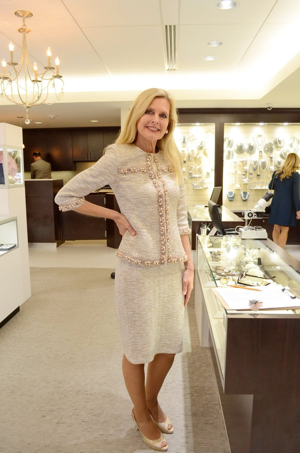 A suit trimmed in faux pearls looked so right at the jewelry sale event.