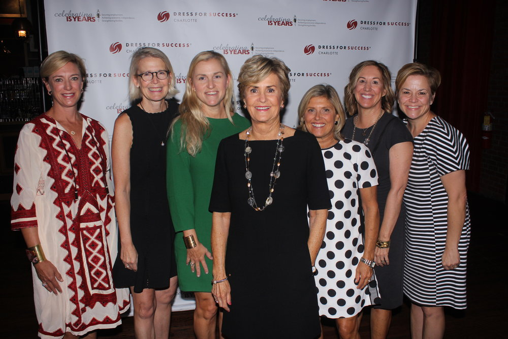 Paradigm Award-winner Jill Dinwiddie is surrounded by women who are also dedicated to making a positive impact during the Dress for Success Charlotte Ultimate Power Lunch fundraiser.   All Photos By Daniel Coston.