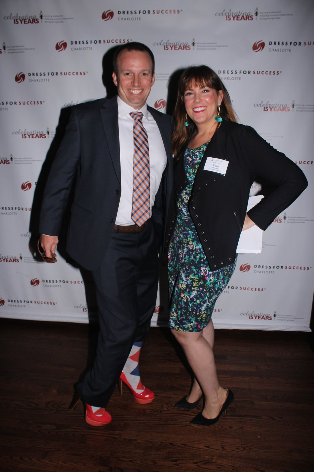 A guest poses with a swaggerer in his high heels.