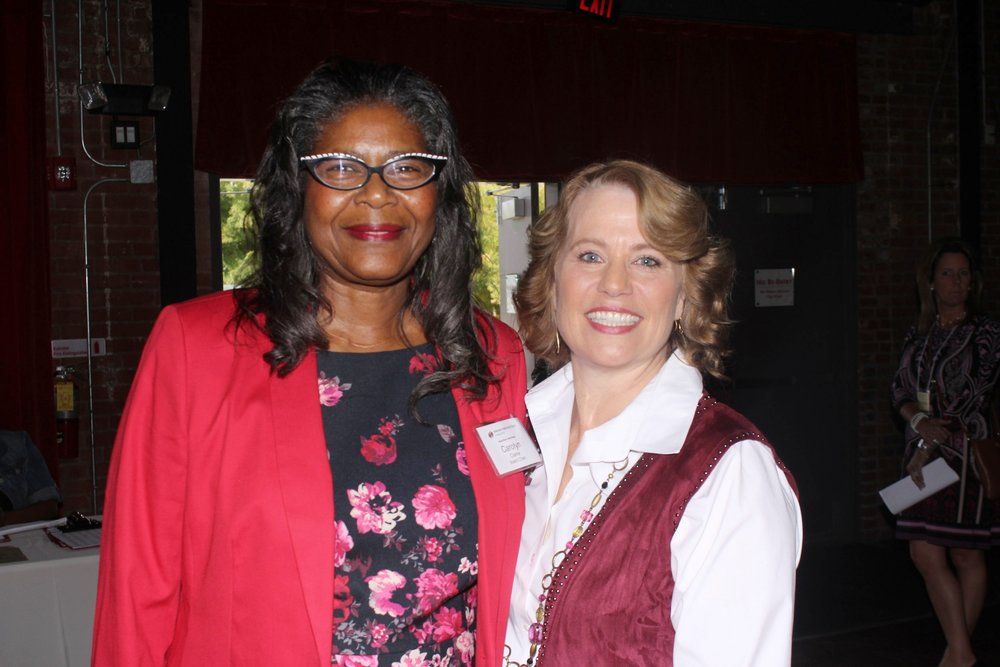 Dress for Success Charlotte board chair Carolyn Clarke with executive director Kerry Barr O'Connor.