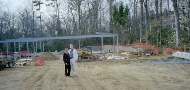 Lynn Ivey with her father during construction of The Ivey.