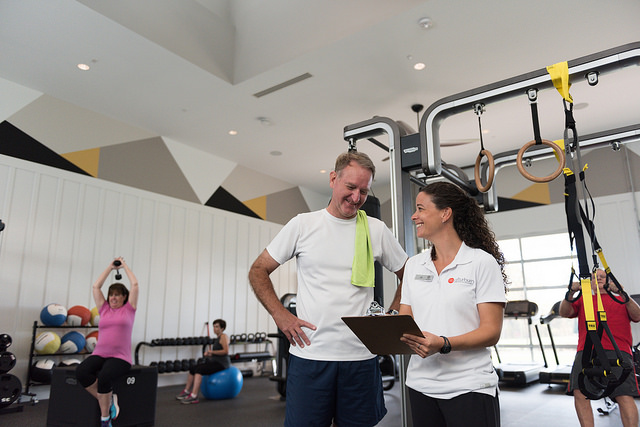 Fitness expert Jill Cerami works with clients at Afturburn, the workout center at Twin Mills Club at Trilogy Lake Norman, a community for 55 and older.  Photo courtesy of Trilogy Lake Norman.