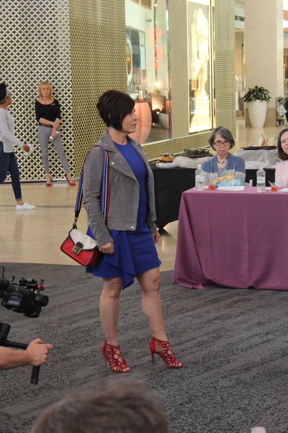 Darla's outfit, including Vince Camuto heels and a two-tone Longchamp bag, were from Nordstrom.