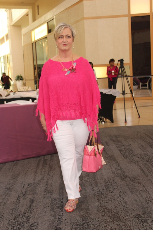 Suzanne Walker in pieces from Dillard's including a pink sweater/poncho from Peter Nygard and multicolor straw sandals from Donald J. Pliner.