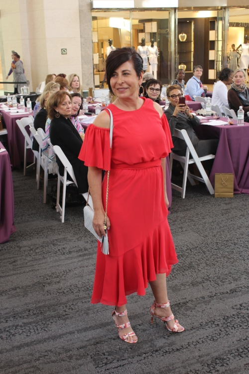 Darla in a look from Nordstrom: a poppy red Eliza J dress, multicolored Louis et Cie heels and a gray Tory Burch bag.