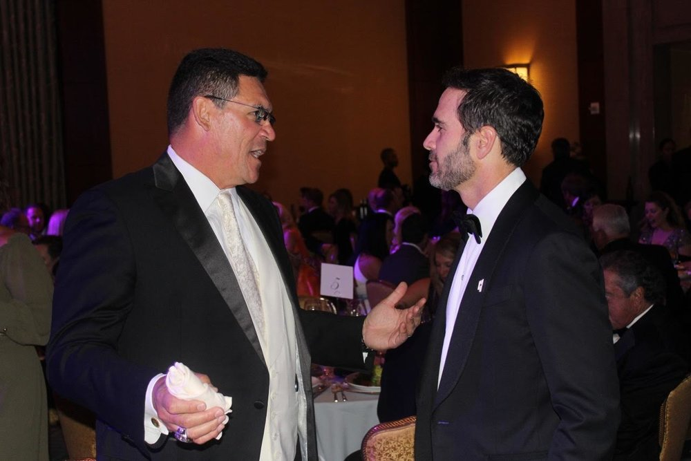 Carolina Panther's Coach Ron Rivera and Jimmie Johnson.