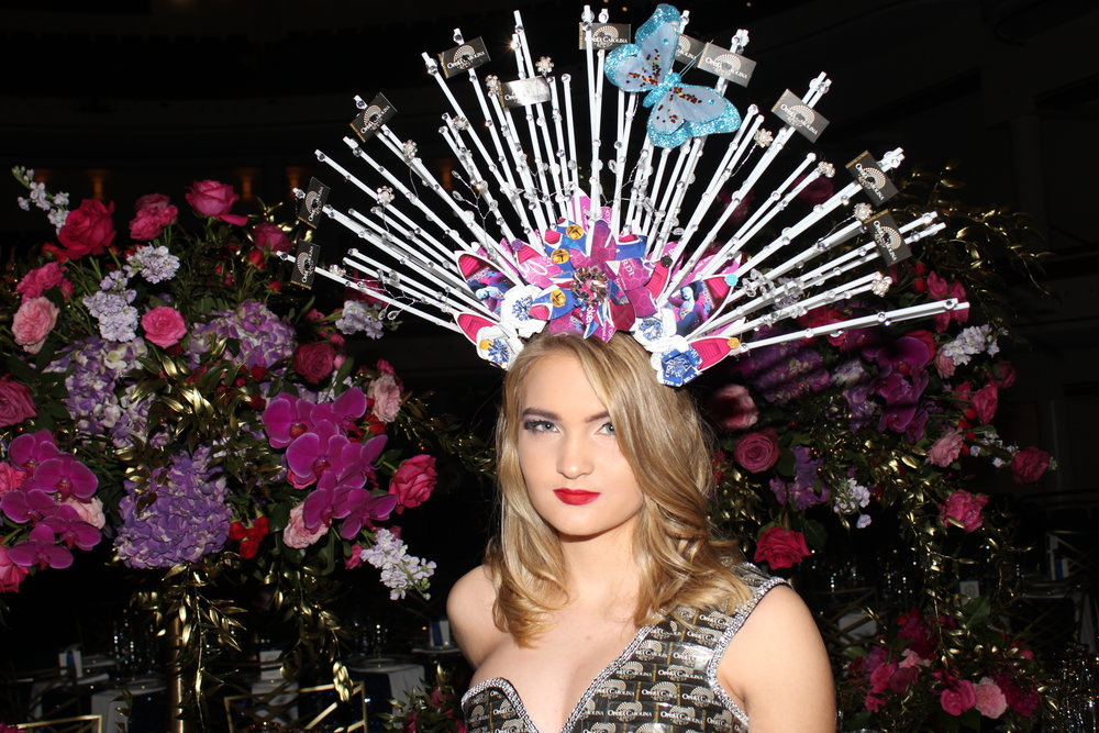 A model shows off a fantastical design made from recycled opera programs during the cocktail hour.