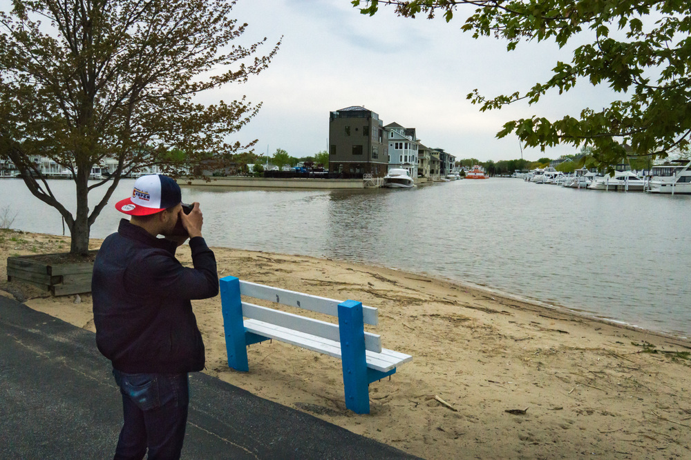 Ron Delhaye taking a photo of the harbor.