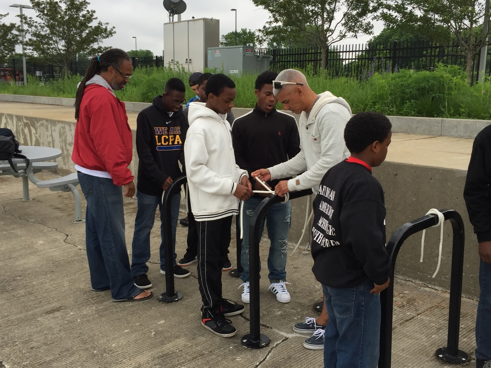 Kevin and David helping the teens learn on tying knots for anchoring boats