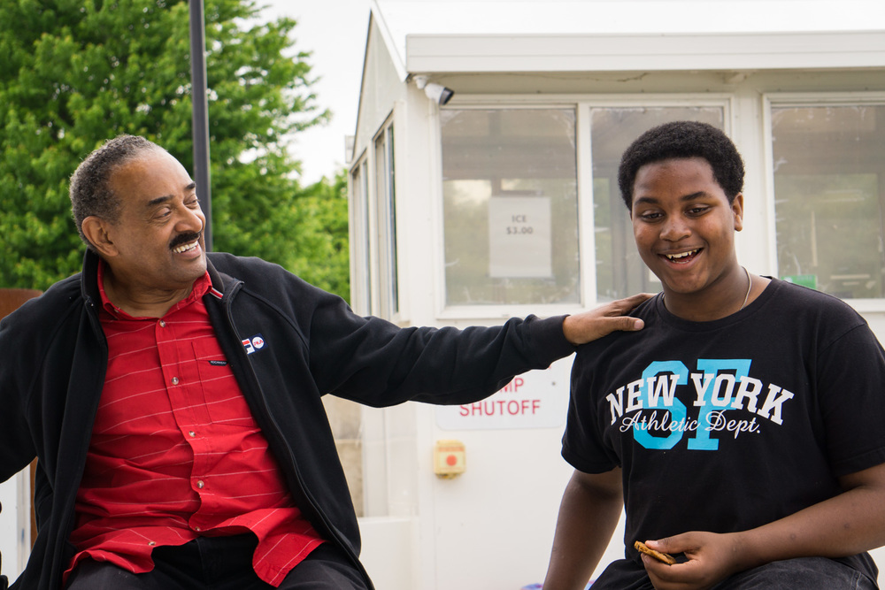 Dr. Vernon Smith having a fun chat with one of the teens.