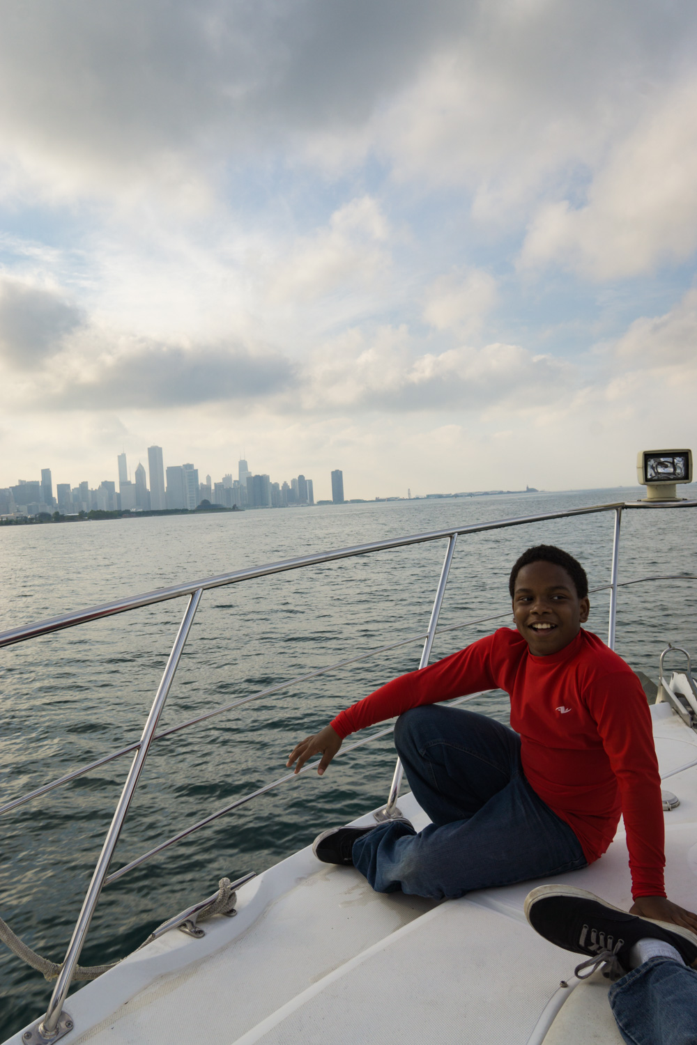 Teen enjoying himself while viewing Chicago from afar