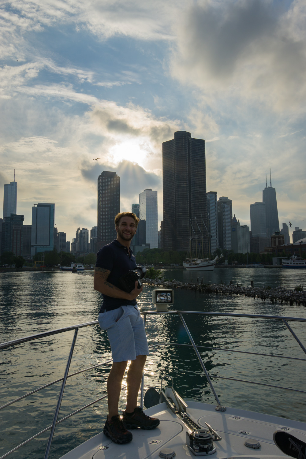 Ron Delhaye standing in front of the Chicago skyline