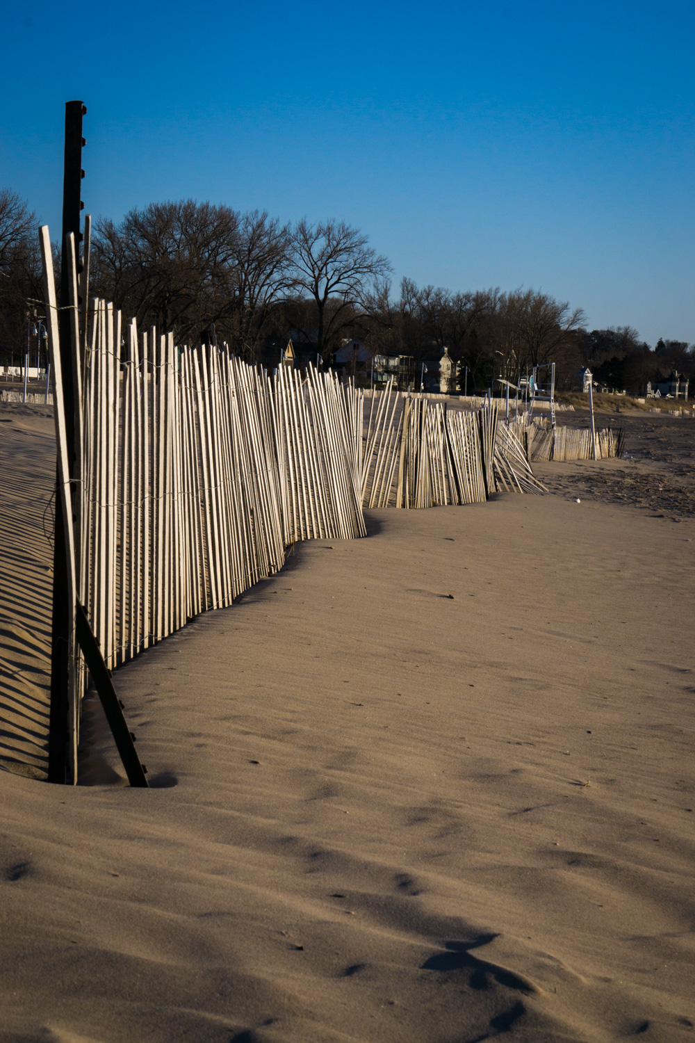 Fence standing among the silver sands