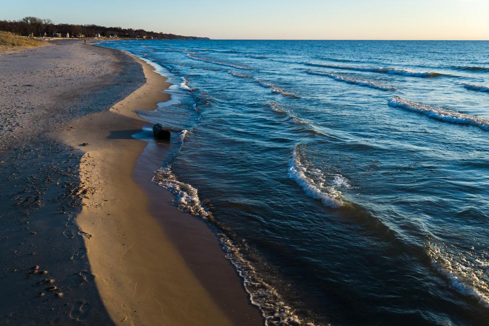 Sunset waves washing ashore
