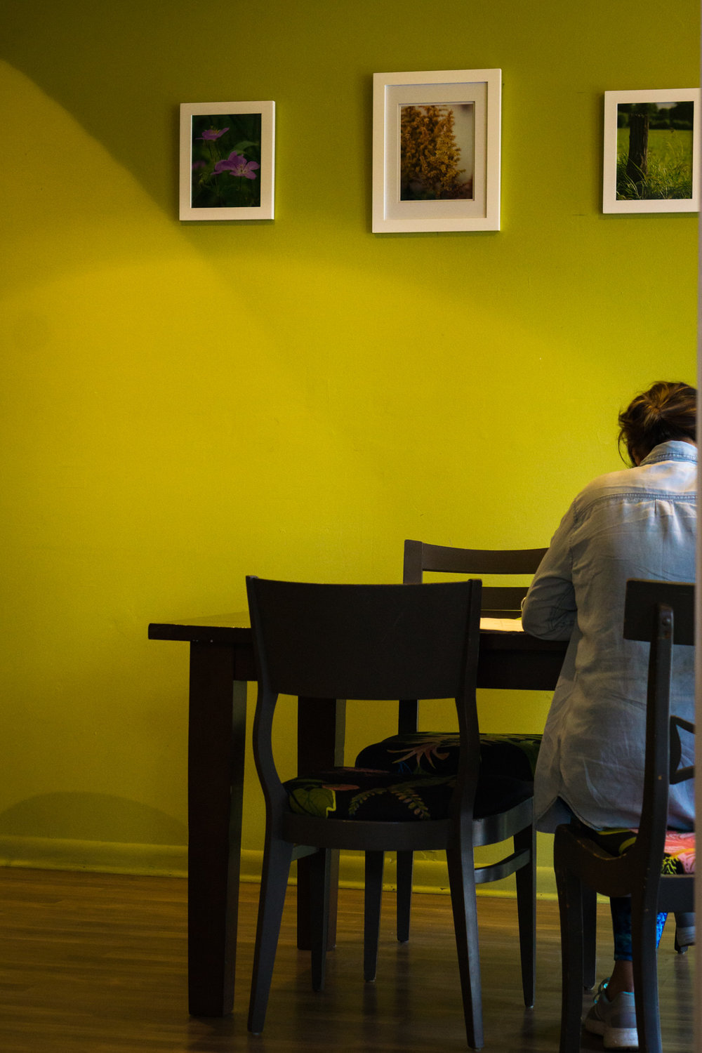 Lady Studying at Roots Organic Juice Cafe